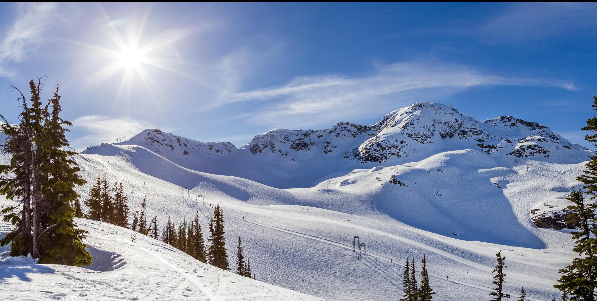 The peak of Whistler Mountain on a sunny day_Adam_Adobe-min